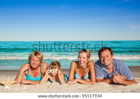 Summer vacation - portrait of happy family at the beach