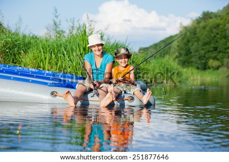 Summer vacation - Sister and brother fishing at the river #251877646