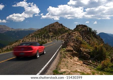 Summer vacation travelers tour through Rocky Mountain National Park in Colorado USA
