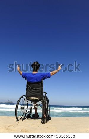summer vacation: wheelchair person enjoying outdoors beach