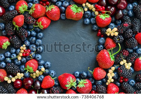 Summer various berries flat lay arrangement with a space for a text, overhead view #738406768