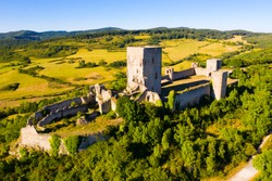 Summer view from drone of medieval Puivert Castle on top of hill, Aude, France