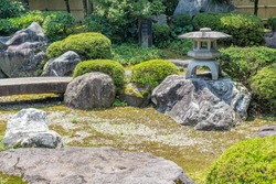 Summer view of a small public traditional garden in the Teramachi district of Kanazawa, Ishikawa Prefecture, Western Japan. The garden is named shosei-en, which means Sound of Bells Park.