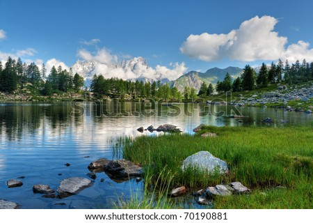 summer view of Arpy lake near La Thuile, Aosta valley, Italy. Image processed with hdr technique