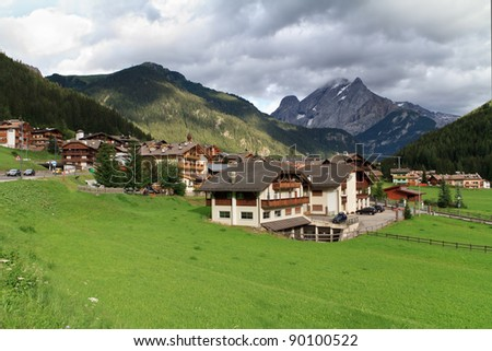 Stock Photo summer view of Fassa valley and Canazei village, Trentino, Italy