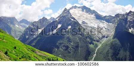 Summer view of high Caucasian mountains. Dombaj, Russia