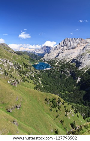 summer view of mount Marmolada and Fedaia lake, Trentino, Italy - Vertical composition