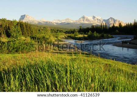 Summer view of mountains and river in glacier national park, montana, usa