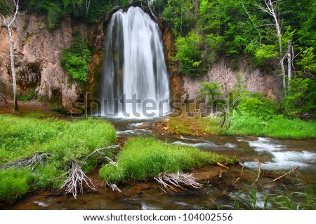 Summer view of Spearfish Falls in the Black Hills National Forest of South Dakota