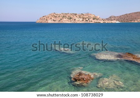 Summer view of Spinalonga island, a Venetian fortress and leper colony, in beautiful Mirabello Gulf, Aegean sea(Crete, Greece)