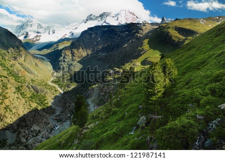 Summer view of the Swiss landscape with Monte Rosa mountains in the background