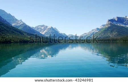 Summer view of the upper waterton lake and mountain from a crusing boat, waterton lakes national park, alberta, canada - stock photo