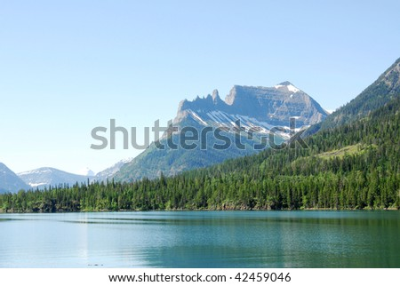 Summer view of upper waterton lake and mountains in goat haunt ranger station, glacier national park, montana, usa