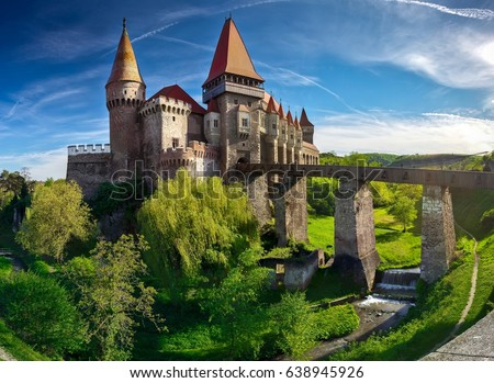 Summer view on Corvin castle with bridge  over a small river in a sunny day in Romania