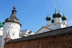 Summer view to the famous russian landmark Rostov the great kremlin with churches and towers under bright blue sky