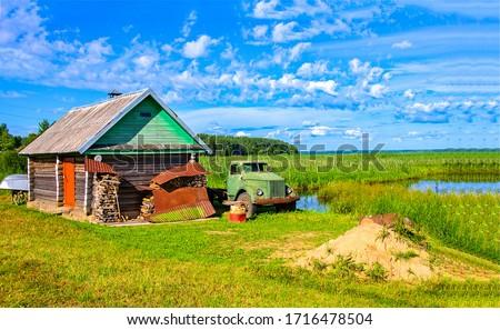 Summer village  farm scene. Truck in summer village. Village truck view
