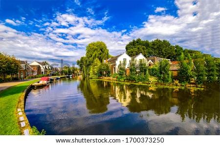 Summer village river houses landscape. Village river landscape. River houses in village town