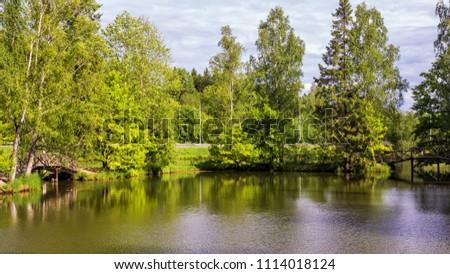 Summer watercourse  landscape with two bridges