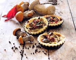 Summer wild mushrooms mini tartelettes with savory short - crust pastry.