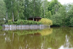 Summer wooden Lake house inside forest . High quality photo