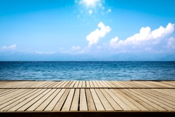 Summer wooden pier of free space for your decoration and ocean landscape with sky and sun light.