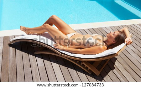 Summer young woman sunbathing in bikini