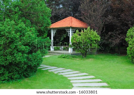 Summerhouse and curving walkway in the garden