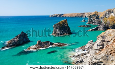 Summers day and turquoise sea at Bedruthan Steps Cornwall England UK