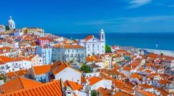 Summertime sunshine day cityscape in the Alfama - historic old district Alfama in Lisbon, Portugal.