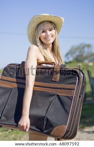 Summertime Traveling Tourist Woman Carrying Her Travel Bag Under One Arm Smiles While On Summer Holidays