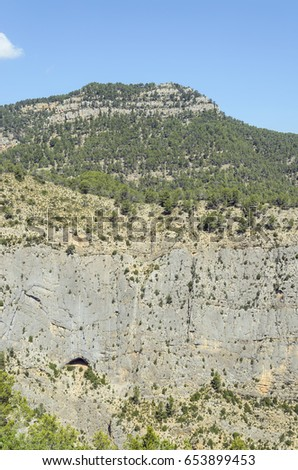 Shutterstock Summit - Morron de Campos - (963 meters of altitude), located in Montanejos, inside the province of Castellon (Valencian Country - Spain). Precipice with a big cave. Rocky landscape. Holidays in Spain