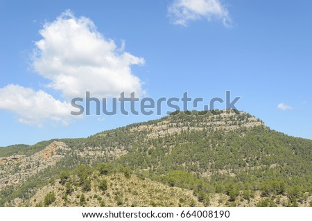 Shutterstock Summit - Morron de Campos - (963 meters of altitude), located in the town of Montanejos, inside the province of Castellon (Valencia - Spain). Natural and beautiful landscape. Blue sky with clouds