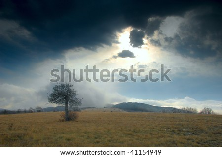 Summit of mountain with view of storm clouds