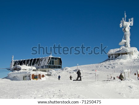 Summit of Whistler Mountain in the winter months as people are getting ready to going skiing and snowboarding