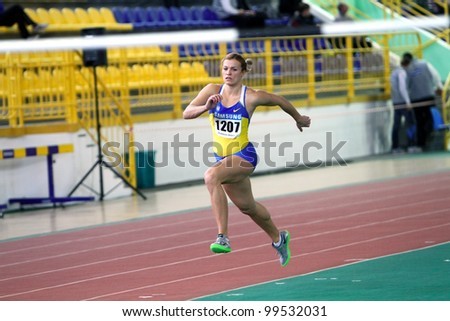 SUMY, UKRAINE - FEB 16: Dobrynska Natallia, Olympic Champion in Beijing, wins the Pentathlon with National Record 4880 p. on Ukainian Track & Field Championships on February 16, 2012 in Sumy, Ukraine.
