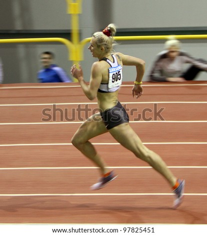 SUMY, UKRAINE - FEB.17: Petlyuk Tetiana - on the 1500 meters dash during the Ukrainian Track and Field Championships on February 17, 2012 in Sumy, Ukraine.