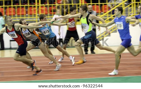 SUMY, UKRAINE - FEB 18: Unidentified men at the relay race on Ukrainian Track & Field Championships on February 18, 2012 in Sumy, Ukraine.