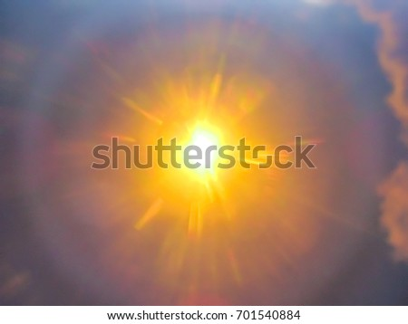 sun and clouds with sun streaks around #701540884