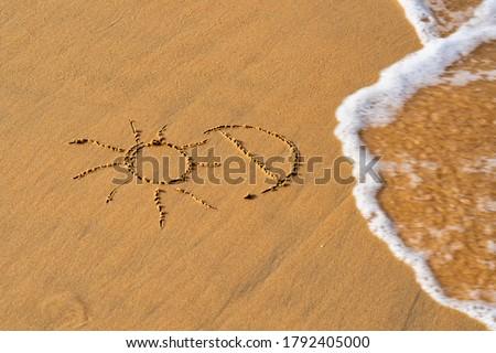 sun and Inscription Vitamin D on the sandy beach Foto stock ©