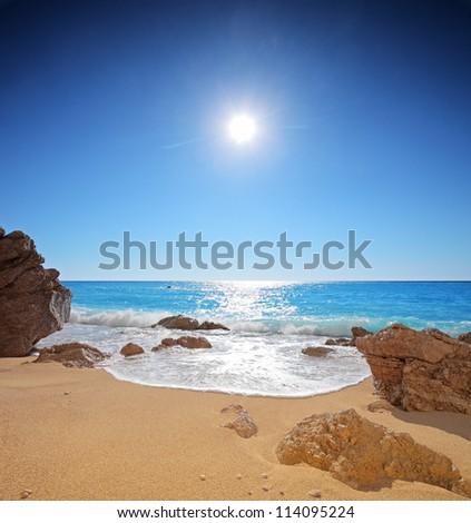 Sun and sea on a sandy beach of Porto Katsiki on the island of Lefkada, Greece - stock photo