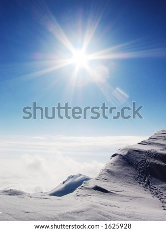 Sun and snow on the Caucasus mountains