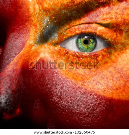 Sun and sun flare painted on a face to show medical conditions concept such as sensitive skin or inflammation. Can als be used to portray a hothead or angry person.