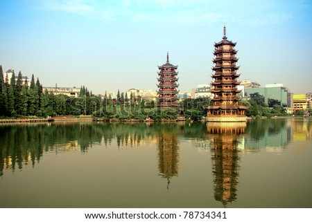 sun and the moon tower in the lake,China