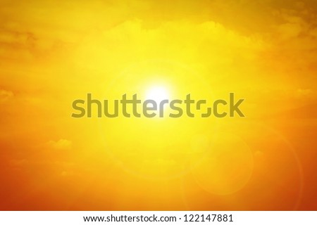 Sun background with clouds and flare - stock photo