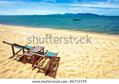 sun beach chair on shore near sea. Thailand
