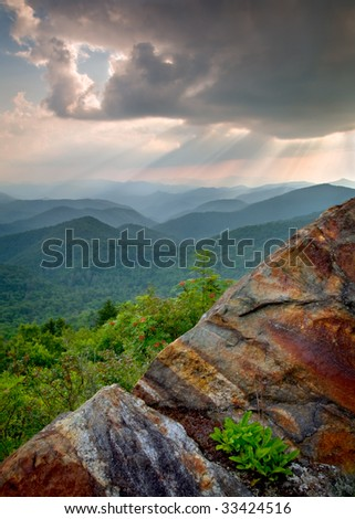 Sun Beams and Rays over Blue Ridge Mountains Rock landscape with flowers