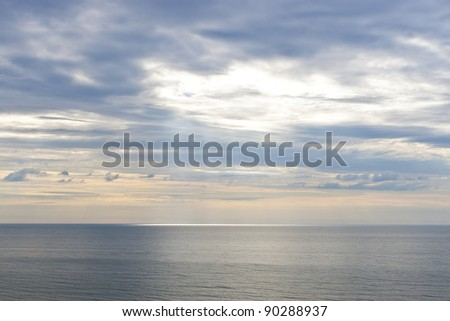 Sun beams on ocean at early morning - stock photo