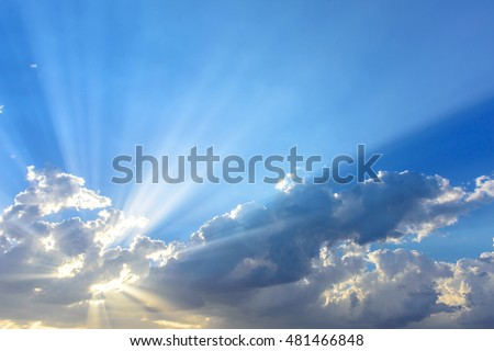 Sun beams or light rays breaking through the clouds. Beautiful spectacular conceptual meditation background.