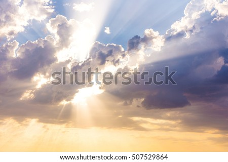 Sun beams or rays breaking through the dark clouds at sunset. Hope, prayer, God's mercy and grace. Beautiful spectacular conceptual meditation background.  Stockfoto ©