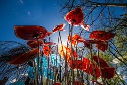 Sun beams through glass flowers sculpture
